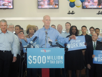Florida Governor Rick Scott during a campaign stop in Brandon in April. - Credit: Janelle Irwin