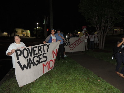 Labor activists lined the sidewalk in front of McDonald's on Kennedy Boulevard hoping to grow support for livable wages. - Credit: Janelle Irwin, May 2014