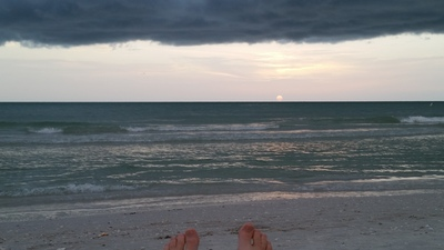 WMNF's Sean Kinane shows off his toes during a stormy Pass-A-Grille sunset.  - Credit: Sean Kinane