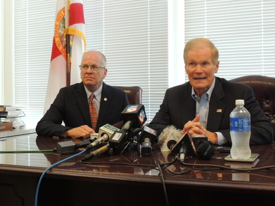 Sen. Bill Nelson (D-FL, right) with Craig Latimer. - Credit: Janelle Irwin/WMNF News (Dec. 2013).
