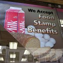 A food stamp sign outside of a Duane Reade pharmacy. Photo by Molly Eyres via Flickr