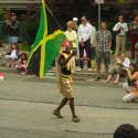 A Jamaican flag is waved in a parade in Vancouver, BC, Canada. photo by john.d.mcdonald via flickr