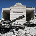 Two destroyed tanks in front of a mosque in Azaz, Syria. Photo by Christiaan Triebert via Flickr.