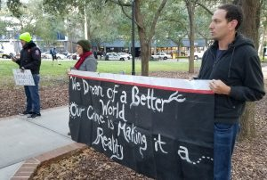 Food Not Bombs sign - We dream of a better world our rime is making it a reality