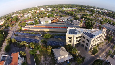 Large_first_housing_hq__35kw_integ._tpo_roof__led_lts.__100kw_solar_car_ports__took_to_zero_energy