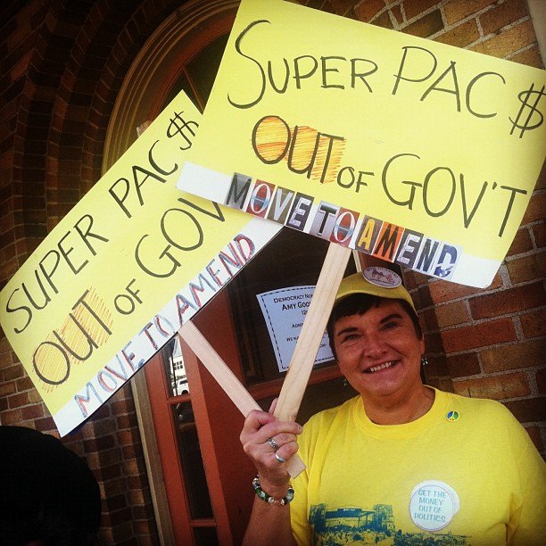 Woman protesting for campaign finance reform and against super PACs