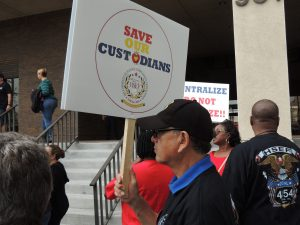 Save Our Custodians sign.