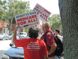 Medicare for All rally signs outside Charlie Crist's office